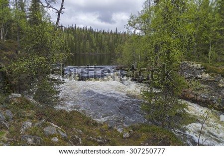 "Start of the first stage of the  ""Short Canyon"" rapids on  Vuosnayoki River, the border of the Murmansk region and Karelia, Russia."