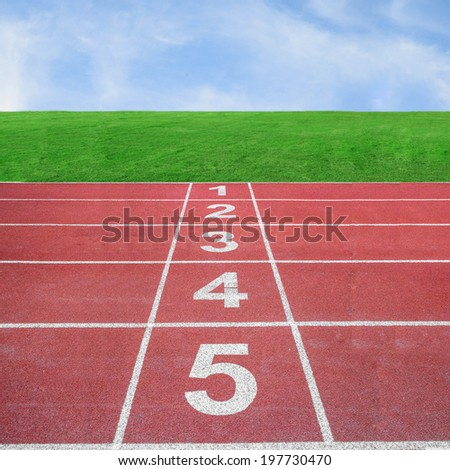 Start or finish position on running track with blue sky