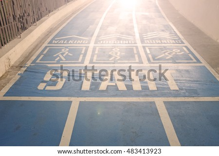 Start point, blue sport running track with sign walk, jogging or run, Light concept to success