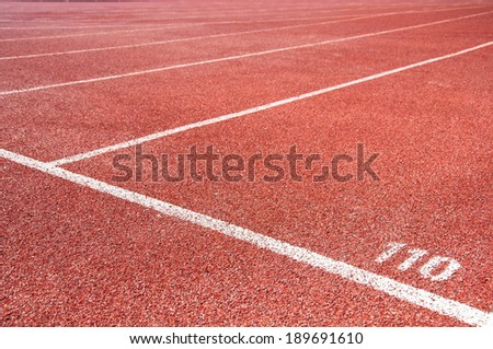 Start point for one hundred and ten meter on running track - stock photo