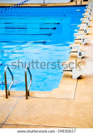 Start position with numbers in swimming pool - stock photo