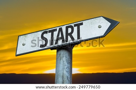 Start sign with a sunset background - stock photo