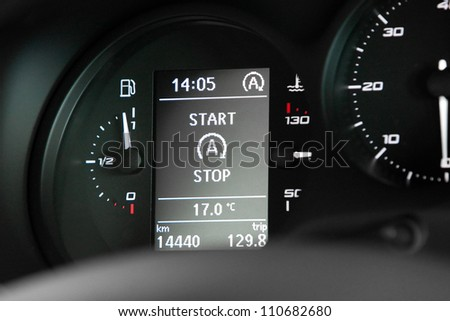 Start Stop technology indicator in dashboard - stock photo