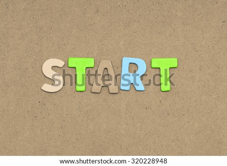 Start text on brown background - stock photo
