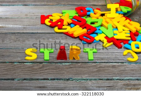 Start text on wood background - stock photo