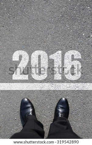 Start to new year 2016 - top view of business man walking on the road - stock photo