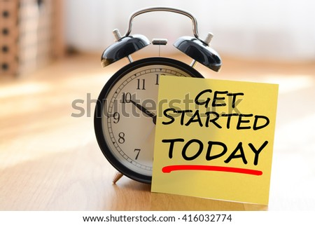 Start today your own business concept with alarm clock and post it message - stock photo