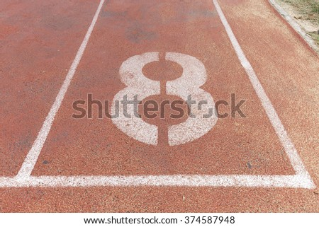 Start track. Lanes 8, number eight of a red racing track. - stock photo
