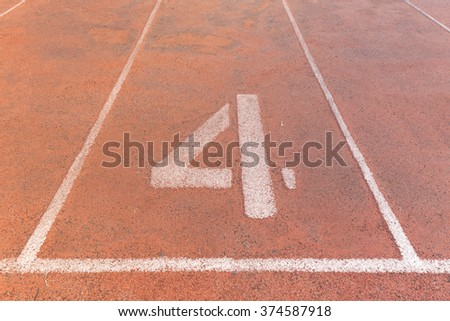 Start track. Lanes 4, number four of a red racing track. - stock photo