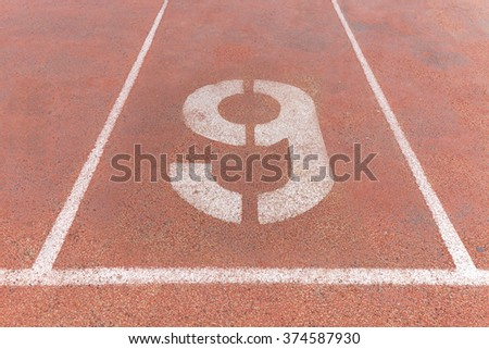 Start track. Lanes 9, number nine of a red racing track. - stock photo