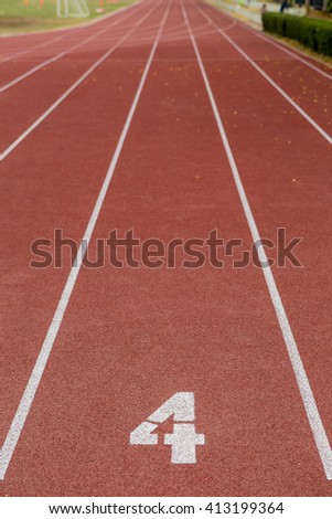 Start track. Lanes 4, number one of a red racing track. - stock photo