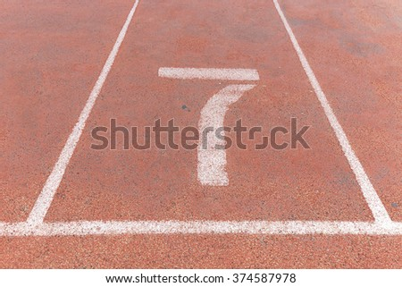 Start track. Lanes 7, number seven of a red racing track. - stock photo