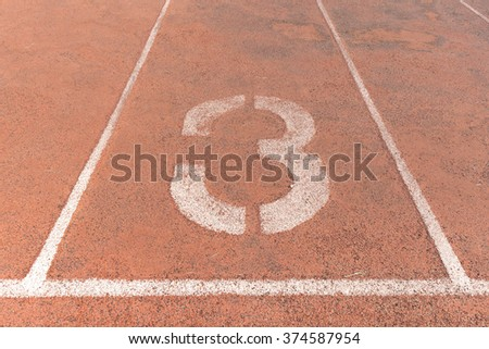 Start track. Lanes 3, number three of a red racing track. - stock photo