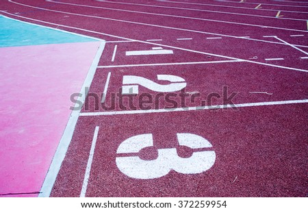 Start track. Lanes 1 2 3 of a red racing track