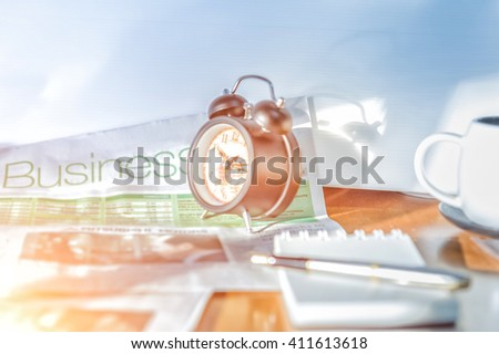 Start up concept.Coffe cup,alarm clock,newspaper,note book, pen.morning coffee day start.Education business place, vintage tone - stock photo