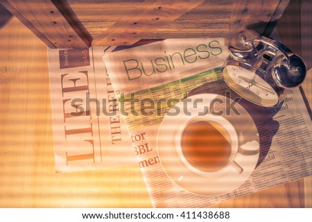 Start up concept.Tea cup,alarm clock,newspaper.morning tea day start.Education business place, vintage tone