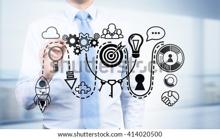 Start up concept with sketching businessman - stock photo