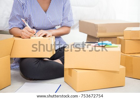 Start up small business entrepreneur SME or freelance asian woman working with box at home concept, Young Asian small business owner, online marketing packaging box and delivery, SME concept