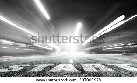 Start word as motivation writen on asphalt road  - stock photo