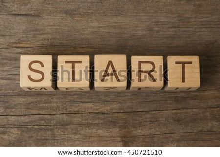 START word on wooden cubes - stock photo