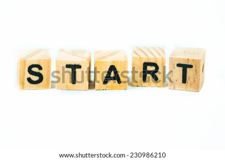 Start words made out of alphabet wood pieces on white background - stock photo
