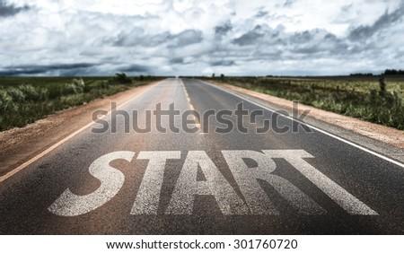 Start written on rural road - stock photo
