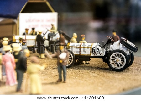 START YOUR ENGINES / Finish line at auto race / old car and people around - stock photo