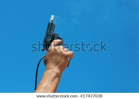 Starter.Hand firing a gun for starting race - stock photo
