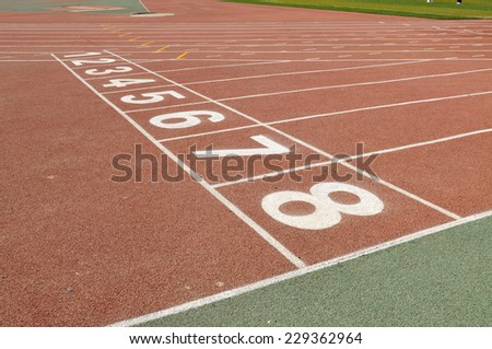 Starting blocks on the sports field - stock photo