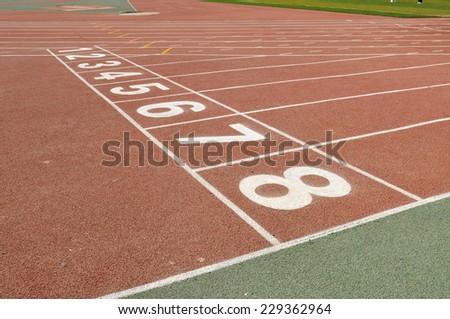 Starting blocks on the sports field - stock photo
