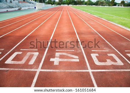 Starting Line of Track Running Lanes in Sports Arena. - stock photo