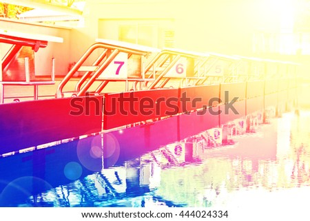 Starting platforms with numbers for swimming races with color filters - stock photo