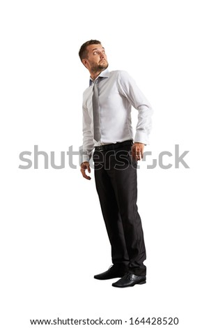 startled businessman looking up. isolated on white background - stock photo