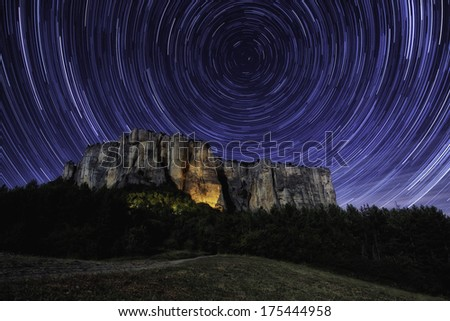 Startrail on the Bismantova stone in Italy - stock photo