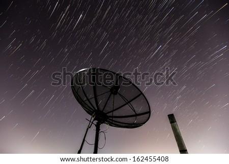 Startrails on Satellite dishes. - stock photo