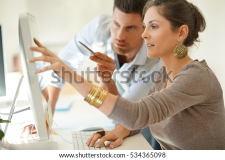 Startup business partners working together in desktop