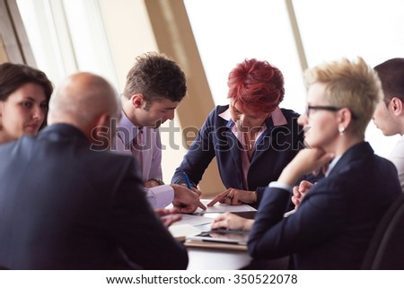 startup business people group have meeting in modern bright office interior, senoir investors  and young software  developers sign contract - stock photo