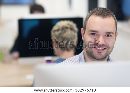 startup business, software developer working on desktop  computer at modern office - stock photo