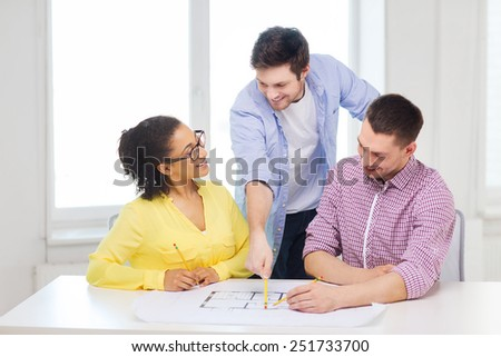 Startup education architecture office concept three stock photo startup education architecture and office concept three smiling architects with blueprint working in malvernweather Gallery