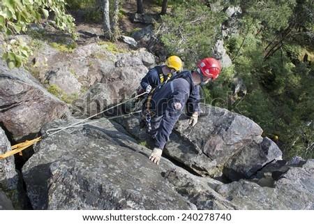 Stary Plzenec, Czech Republic, June 3, 2014: training rescue team. Rescue in rocky terrain near the castle RADYNE. - stock photo