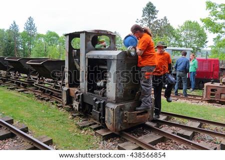 STARY PLZENEC, CZECH REPUBLIC - MAY 14, 2016: Maintenance of mining locomotive MD2 on narrow-gauge railway. Outdoor museum in Stary Plzenec, Czech republic, Europe. - stock photo