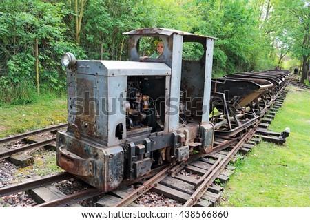 STARY PLZENEC, CZECH REPUBLIC - MAY 14, 2016: Mining locomotive MD2 with wagons on narrow-gauge railway. Outdoor museum in Stary Plzenec, Czech republic, Europe. - stock photo