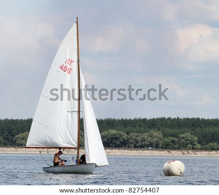STARY SALTOV,UA - AUGUST 6: Class Flying Dutchman sailing boats unidentified participants compete during Slobozhanshina Sailing Cup. August 6, 2011 in Stary Saltov, Ukraine