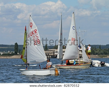 STARY SALTOV,UA - AUGUST 6: Class Optimist sailing boats unidentified participants compete during Slobozhanshina Sailing Cup. August 6, 2011 in Stary Saltov, Ukraine