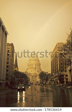 State Capitol Building in Madison and the rainbow. - stock photo