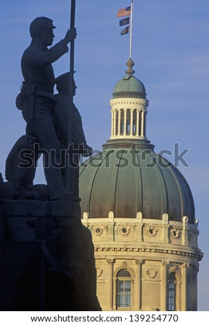 State Capitol of Indiana with silhouette of a statue in the foreground in Indianapolis, Indiana - stock photo