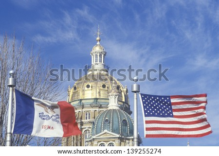 State Capitol of Iowa and state flag in Des Moines, Iowa - stock photo