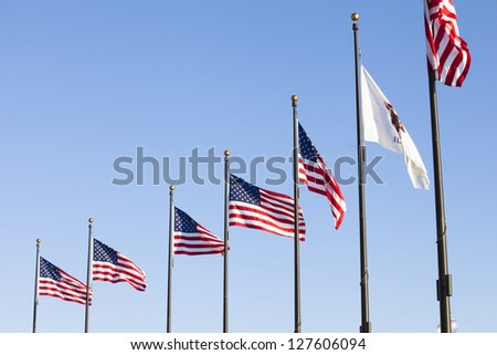 State Flag of Illinois and USA flags in the wind - stock photo