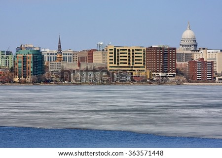 State of Wisconsin Capitol as seen across lake Monona, early spring view. - stock photo