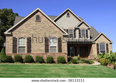 Stately brick home somewhere in the middle of the USA. - stock photo